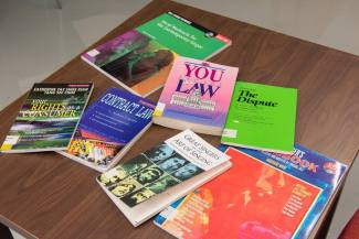 Books from Karaoke Court reading room